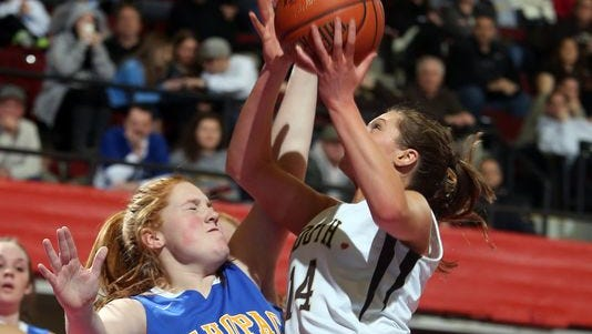 Clarkstown South's Caitlin Collamore is defended by Mahopac's Courntey McCormack during a Class AA girls basketball semifinal at the Westchester County Center in White Plains Feb. 27, 2014. Mahopac defeated Clarkstown South 60-52.