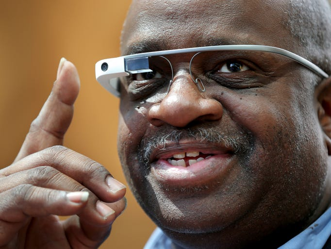 Philip Mosley of Indianapolis takes a photograph using a pair of Google Glasses during the demonstration put on by the Indiana Pacers at the Indianapolis Public Library on Thursday, April 17, 2014. Library visitors learned about and got the chance to experience the new technology that has been featured at recent Pacers games. Google Glass displays information in a hands-free format that allows wearers to communicate with the internet by using voice commands. The Pacers also donated two Google Glasses for the library to provide ongoing public training.