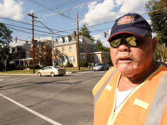 Crossing guard George Jones works the intersection of Sixth Street and Lincoln Way East on Wednesday, September 14, 2016. There is a crossing guard shortage in the Chambersburg School District.