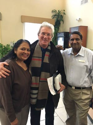"Comfort Suites General Manager Jay Patel and his wife, Judy, pose with actor Richard Gere while he was in Gettysburg, Pa., filming scenes from the upcoming movie ""The Dinner."""