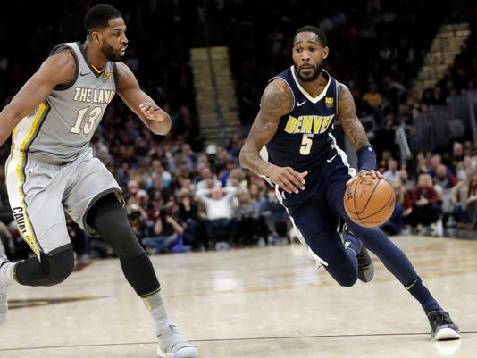 Denver Nuggets' Will Barton (5) drives past Cleveland Cavaliers' Tristan Thompson (13) in the second half of an NBA basketball game, Saturday, March 3, 2018, in Cleveland. The Nuggets won 126-117. (AP Photo/Tony Dejak)