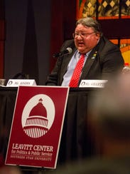 City council candidate Ron Adams speaks during a debate