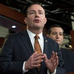 FILE - In this Feb. 12, 2015 file photo, Sen. Mike Lee, R-Utah, accompanied by Republican Presidential candidate, Sen. Ted Cruz, R-Texas, speaks during a news conference on Capitol Hill in Washington, Congress' debate over domestic surveillance is scrambling partisan divisions in the Senate as libertarian-minded Republicans defy their leaders to make common cause with liberal Democrats.  (AP Photo/Molly Riley, File)