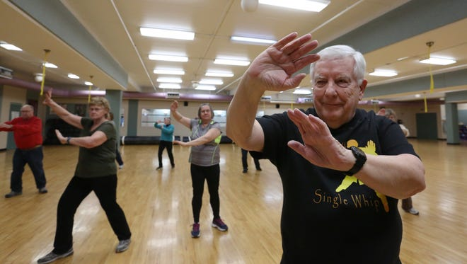 Certified Tai Chi instructor Jerry Galas, right, teaches Tai Chi class at the Manitowoc-Two Rivers YMCA on Thursday. The Tuesday and Thursday Tai Chi classes at the Y are free to the public to attend.