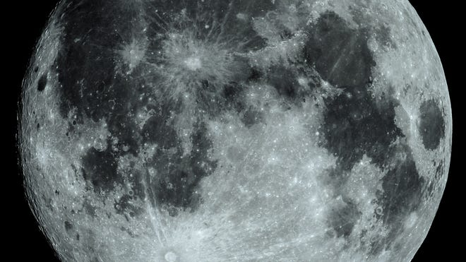 Full Moon, taken with ISO 100, several stacked images to show the details usually not visible to the eye alone. Impact craters, mountain ranges and relatively flat 'seas' can be seen. The impact crater Tycho near the bottom of the photograph, shows ejecta rays of material wrapping around the Moon's surface.