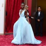 Lupita Nyong'o wears Nairobi blue to Oscars