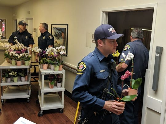 Salinas firefighters deliver flowers for seniors on Mother's Day.