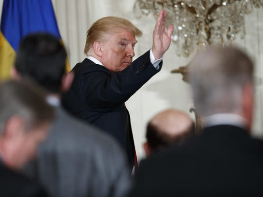 President Donald Trump waves as he walks off after a news conference with Swedish Prime Minister Stefan Lofven in the East Room of the White House, Tuesday, March 6, 2018, in Washington. (AP Photo/Evan Vucci)