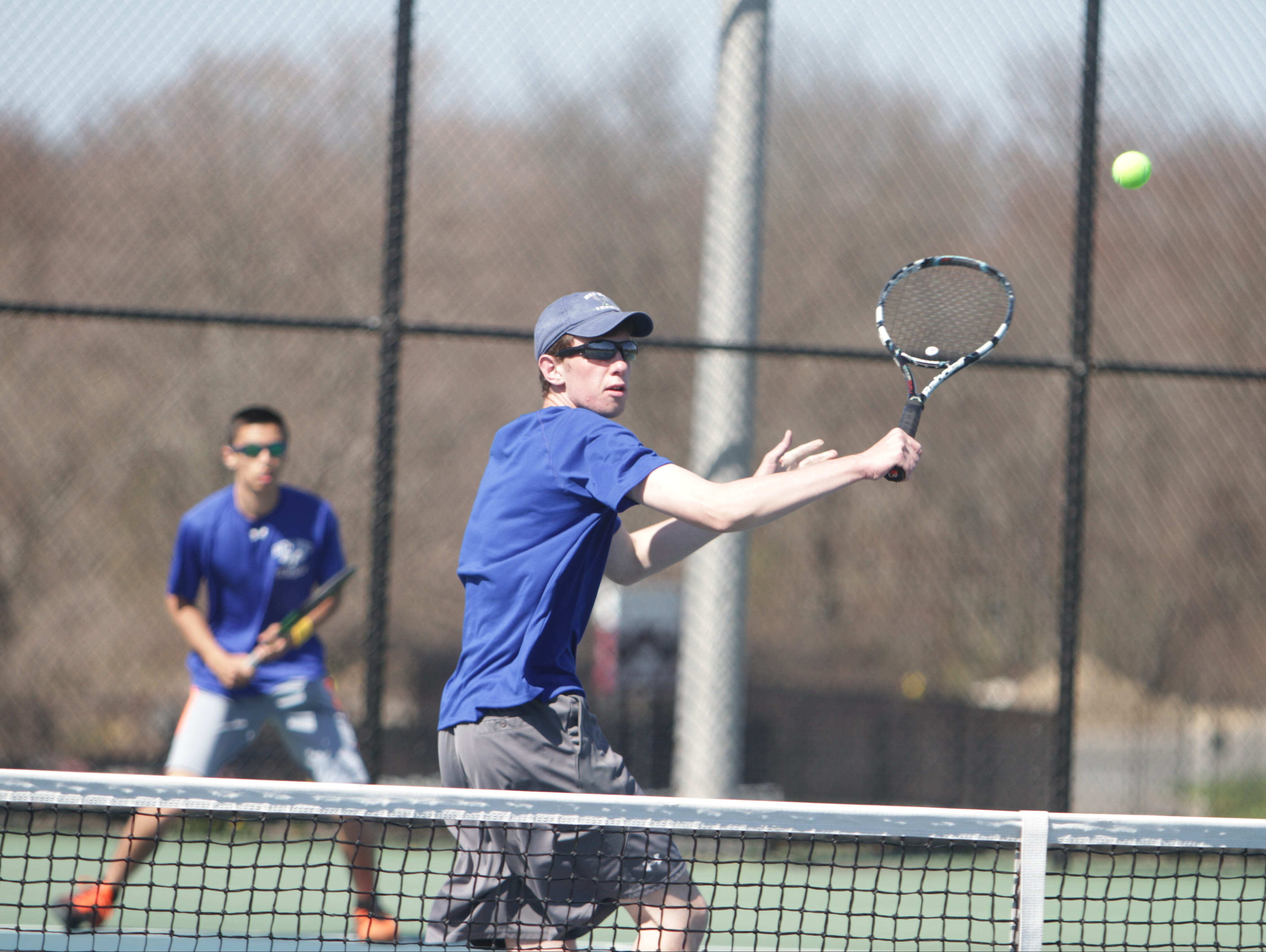 Hen Hud's Kennan Ewing hits a volley during the San Marco Tournament at Harrison High School on April 17.