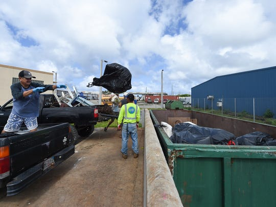 Customers dump their garbage at the Guam Solid Waste Authority Harmon Transfer Station on Dec. 9, 2017.