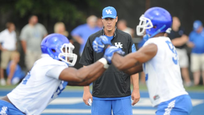 Defensive coordinator D.J. Eliot watches a drill during the University of Kentucky Football fan day at the Nutter Field House in Lexington, Ky., on Saturday August 8, 2015.