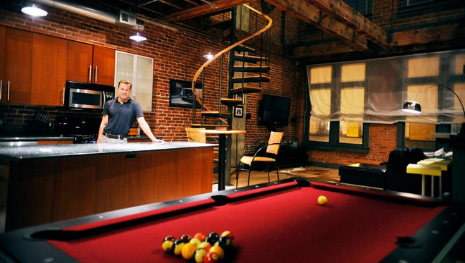 With some help, Jason Bross designed his loft on North George Street when he moved in about eight years ago. Special touches include the parachute material he uses as curtains, a cracked-glass countertop for his wet bar and a spiral staircase that leads from the living area to his upper-story bedroom.