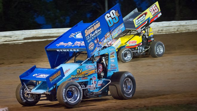 Lance Dewease (69K) flies past Aaron Ott in a heat race during the World of Outlaws Summer Nationals on Saturday at Williams Grove Speedway. Dewease won the $25,000 payday.