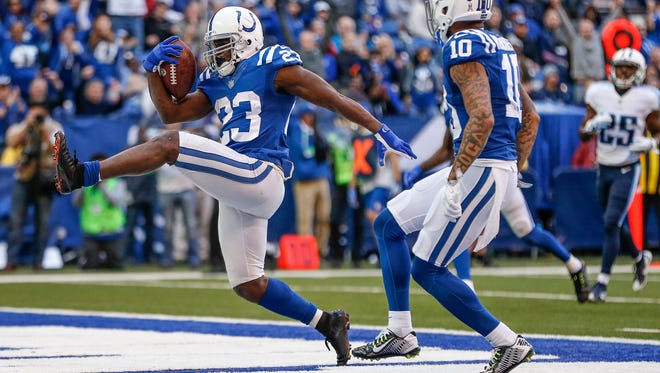 Indianapolis Colts running back Frank Gore (23) high-steps into the end zone for the touchdown against the Tennessee Titans at Lucas Oil Stadium in Indianapolis on Sunday, Nov. 26, 2017.