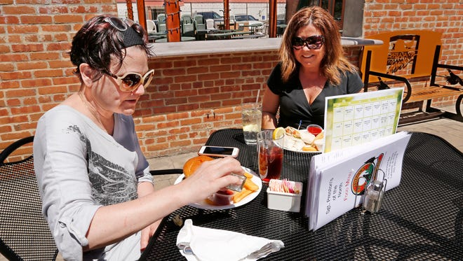 Heather Richard, left, and Jessie Gingrich sit down to enjoy lunch outdoors at Sgt. Preston's of the North Thursday, April 26, 2018, at 1204, 6 N. Second Street in downtown Lafayette. Richard opted for the buffalo burger and fries while Gingrich went with the fiesta wrap. Both women said the dine at Preston's often.