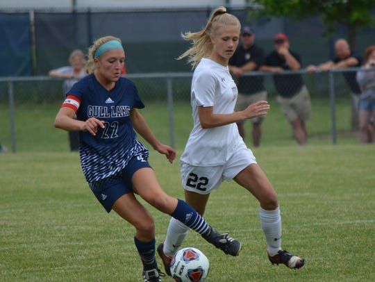 Gull Lake's Taylor Wesley dribbles past Marshall's
