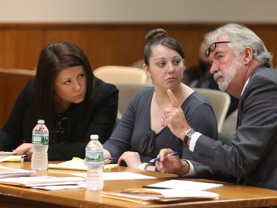 Sarah Wesley, one of Erica Bell's attorney leans into