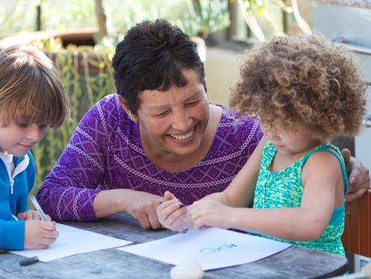 GettyImages-Woman-coloring-with-child.jpg