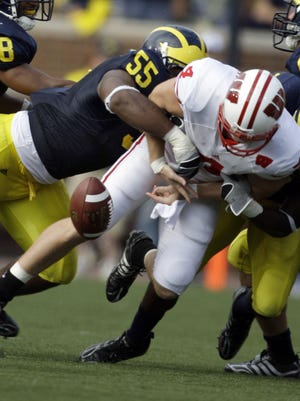 Michigan's Brandon Graham, left, and Stevie Brown were part of a legendary comeback in 2008 against Wisconsin.