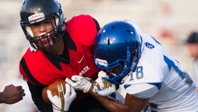 Jeshaun Jones, wide receiver for South Fort Myers, attempts to get away from Michael Mclay from Barron Collier during the game against South Fort Myers on Friday, May 19, 2017 at Barron Collier High School in North Naples.