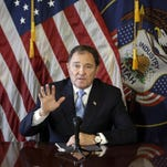 Utah Gov. Gary Herbert speaks to reporters during a news conference at the Utah State Capitol in Salt Lake City.