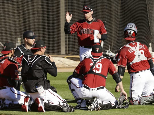 Coach Robby Hammock talks to Diamondbacks catchers