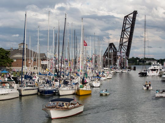 Hundreds of boats fill the Black River during Boat Night Friday, July 15, 2016 at Blue Water Fest in downtown Port Huron.