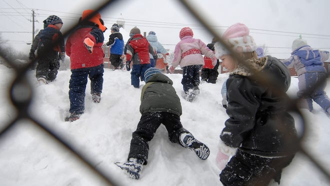 Wausau children stay active while playing in the snow in this 2008 file photo.