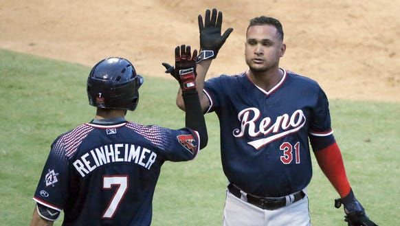 Oswaldo Arcia, 31, of the Reno Aces is congratulated