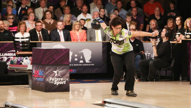 Liz Johnson, 41, throws a ball en route to winning her second United States Bowling Congress Queens championship on Tuesday in Ashwaubenon.