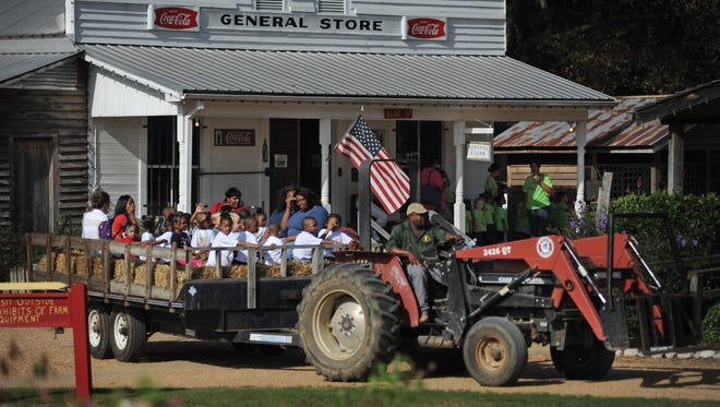 A group of preschoolers enjoys a hayride through Small Town Mississippi during the annual AG Museum Pumpkin Adventure in October 2014 at the Mississippi Agriculture and Forestry Museum in Jackson.