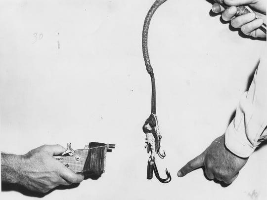 """06/21/1950 GANG WEAPONS -Equipment carried by juvenile gang membersin thier forays against compeition members could be deady. A whip with fish hoots attached is shown with a side view of the """"Zip gun."""" (Photo by Arcy)"""