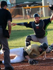 Roswell catcher Jim Smith tags out Zac Johnson on Sunday