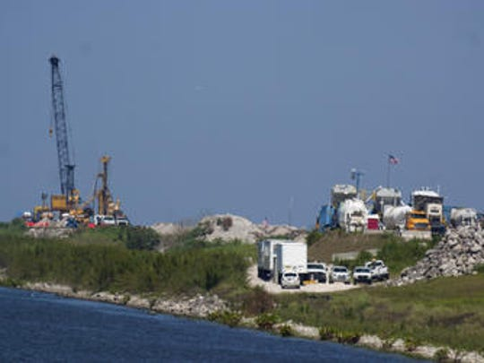Workers rehabilitate the Herbert Hoover Dike around Lake Okeechobee on Friday, April 1, 2011, south of Pahokee.