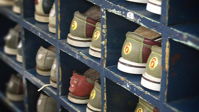 Bowling shoes all in a row; Dart Bowl's Dollar Mania night.  Photo by: Tammy Perez Date: 3/24/2008