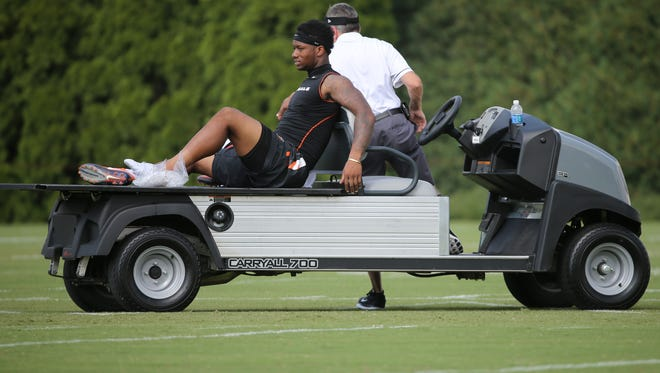Cincinnati Bengals running back Joe Mixon (28) is seen on a training cart during Cincinnati Bengals training camp practice. He turned out to be OK after a kick to the heel.