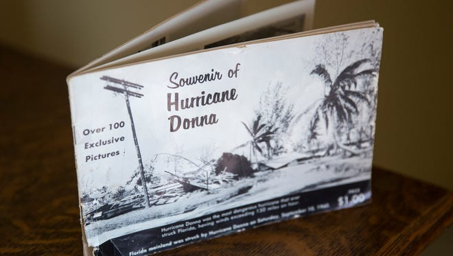 Heather Pilkenton's original copy of her grandfather Joe Coleman's photography booklet, documenting the aftermath of Hurricane Donna in 1960. Pilkenton has begun to document the aftermath of Hurricane Irma in the same way, revisiting the locations her grandfather photographed.