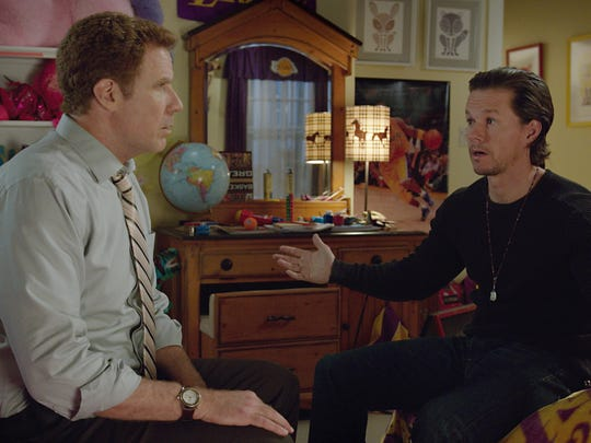 Brad (Will Ferrell, left) and Dusty (Mark Wahlberg) have a heart-to-heart in 'Daddy's Home.'