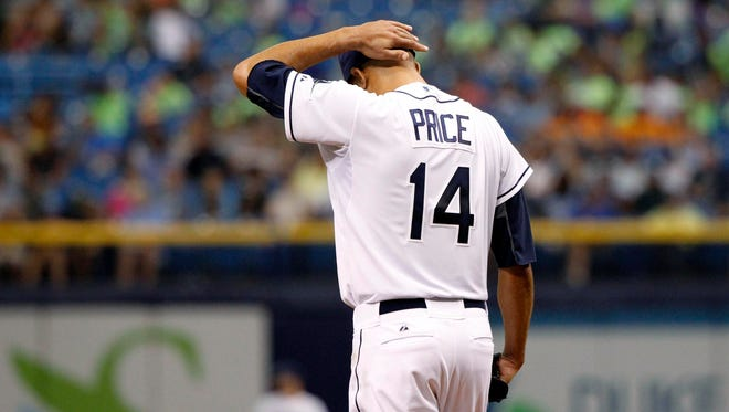 Jul 30, 2014; St. Petersburg, FL, USA; Tampa Bay Rays starting pitcher David Price (14) reacts during the second inning against the Milwaukee Brewers at Tropicana Field. Mandatory Credit: Kim Klement-USA TODAY Sports