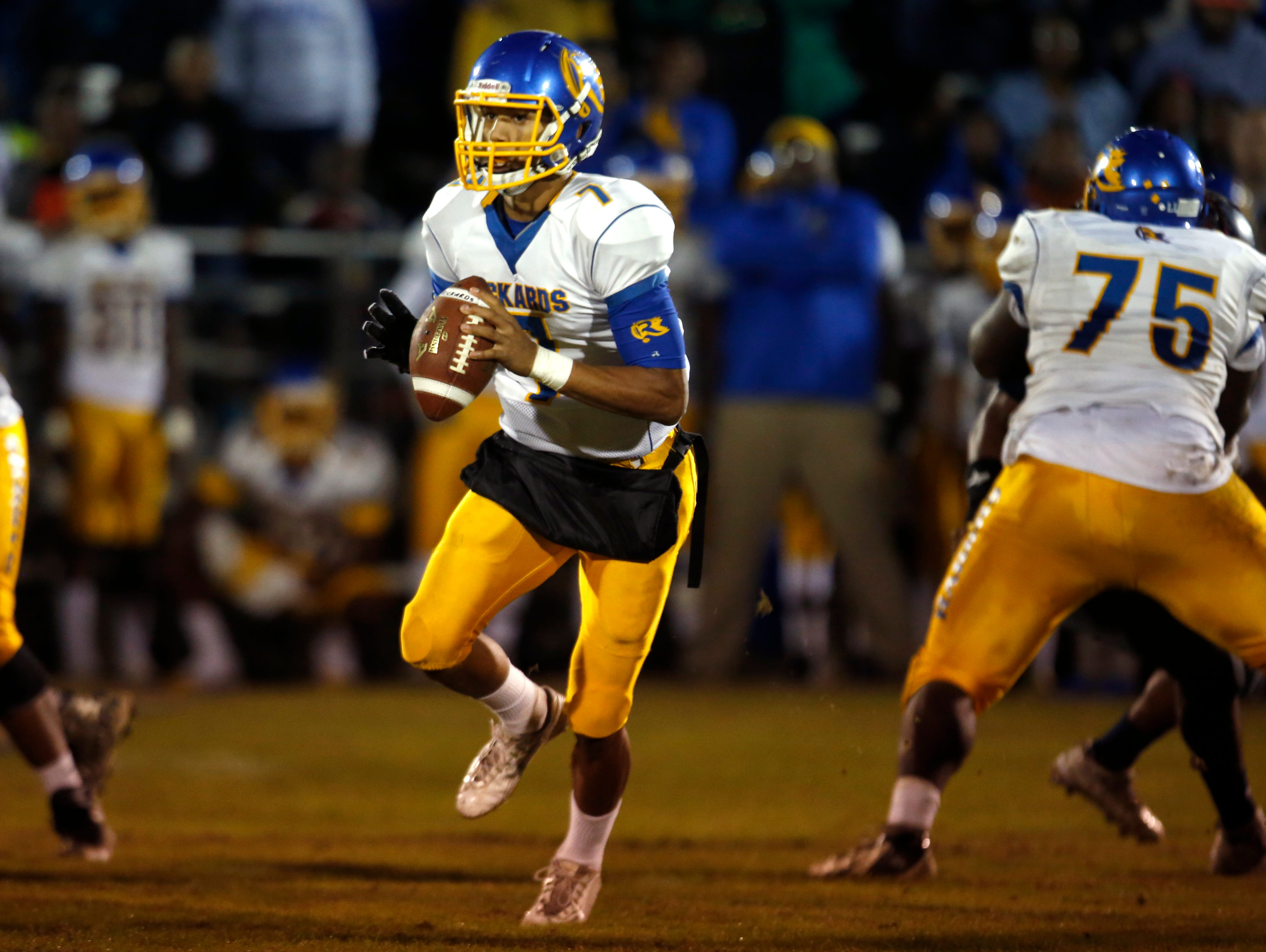 Rickards quarterback Dj Phillips looks to throw the ball against Wakulla during their playoff game on Friday.