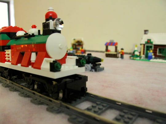 A train whizzes around the Christmas village in Debra Packer's living room.