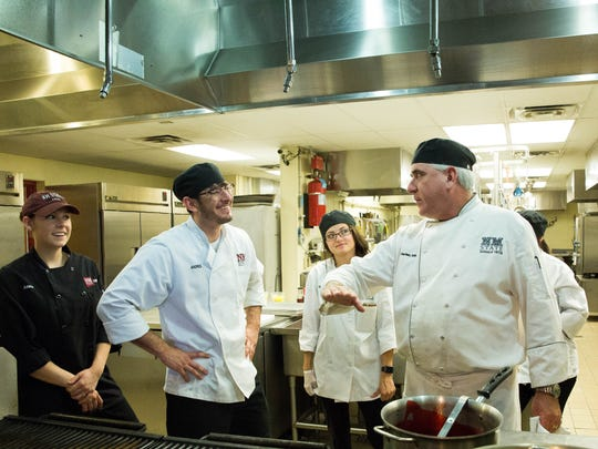 John Hartley, chef and professor who runs 100 West Café at New Mexico State University, gives students last minute instructions before the lunch rush starts, Friday April 28, 2017.
