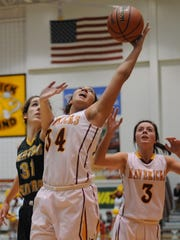 Maverick junior Taryn Elliot stretches out to pull in a rebound for McCutcheon in Friday night's J&C Hoops Classic.