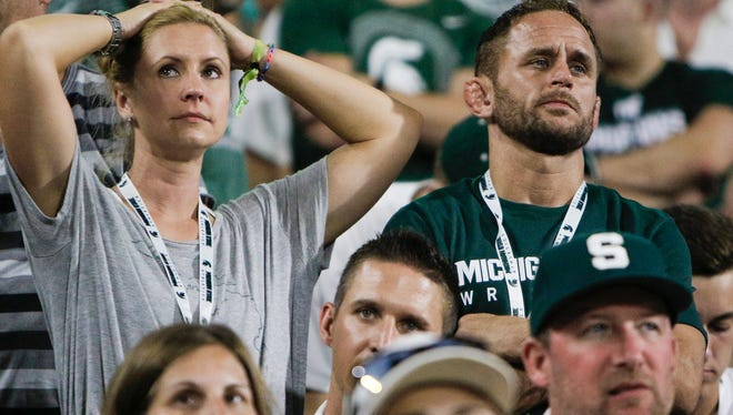 Spartan football fans react as the Spartans trail Notre Dame 28-7 at the half Saturday, Sept. 23, 2017.