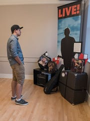 Gio Marterella checks out an exhibit of vinyl and the history of 88.1 The Park WSDP-FM.
