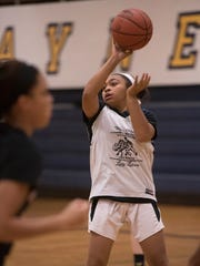 Showing her skills during a Wayne Memorial practice is senior point guard Camree Clegg. Her prep career skyrocketed after transferring from Detroit Country Day in 2015.