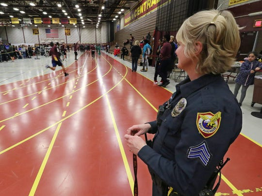 West Allis Police School Resource Officer Sgt. Nicole Moews in the West Allis Central fieldhouse before the start of an invitational track meet on Nov. 23.