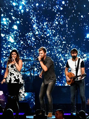 Lady Antebellum's Hillary Scott, left, Charles Kelley and Dave Haywood headlined Bridgestone Arena for the first time Friday.