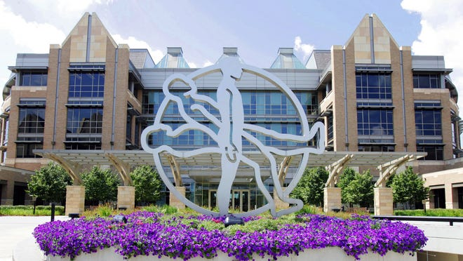 """The """"Rising Man"""" symbol stands in front of the Fridley, Minn.-based Medtronic."""