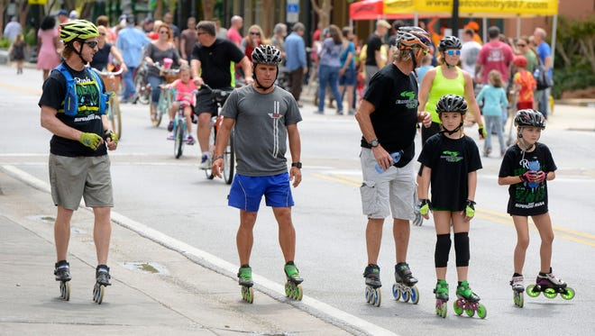 People play games, walk, bike and skateboard the streets Saturday during the Ciclovia in downtown Pensacola.